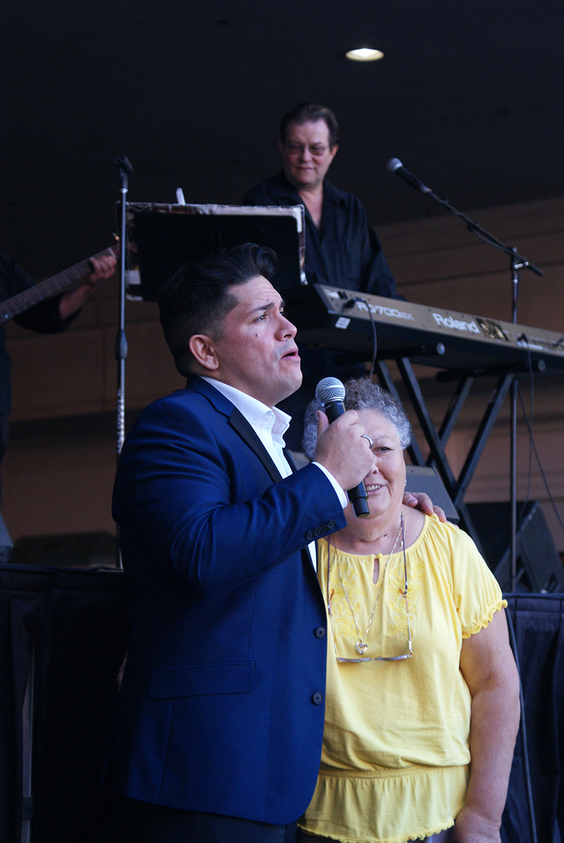 "A ""nonna"" being serenaded by one of the singers performing at the festival."