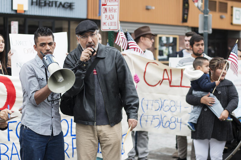 Mario de la Rosa (right), journalist and activist, at the pro-immigration rally under the Reno Arch. 20 Nov. 2015.