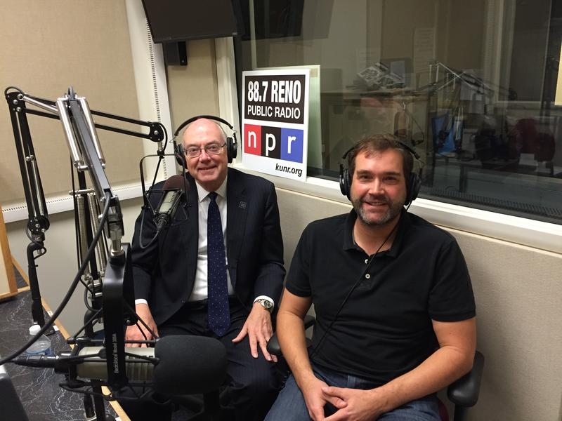 University of Nevada, Reno President Marc Johnson (left) visits with the University's Monster Fish researcher Dr. Zeb Hogan in the KUNR Studios. 12-2-15