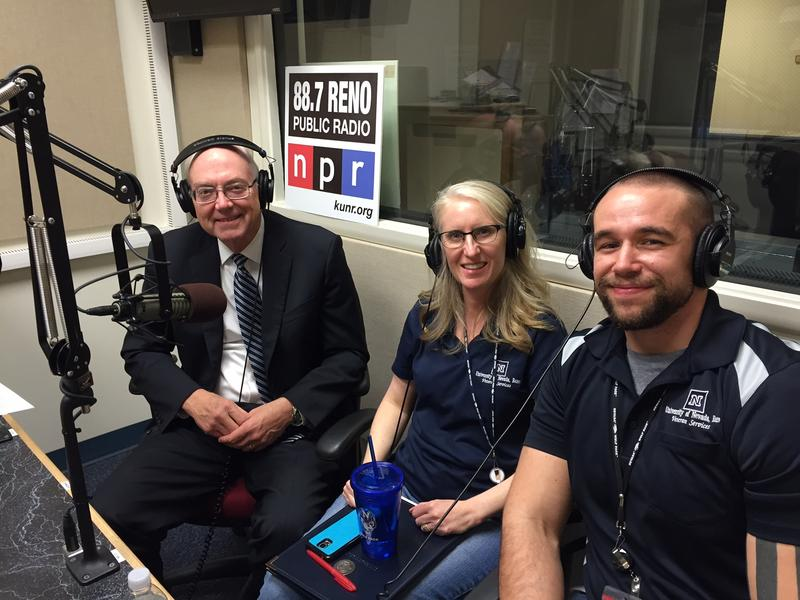 President Marc Johnson (left) visits with Terina Caserto and Gabe Kennedy in the KUNR studios.