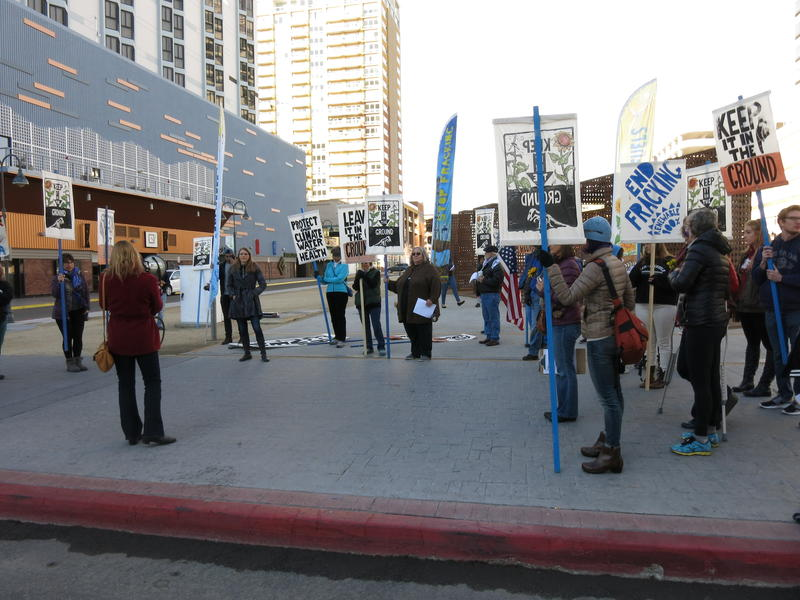 Protestors hear from speakers before marching to Silver Legacy, where the Nevada BLM auction was taking place.