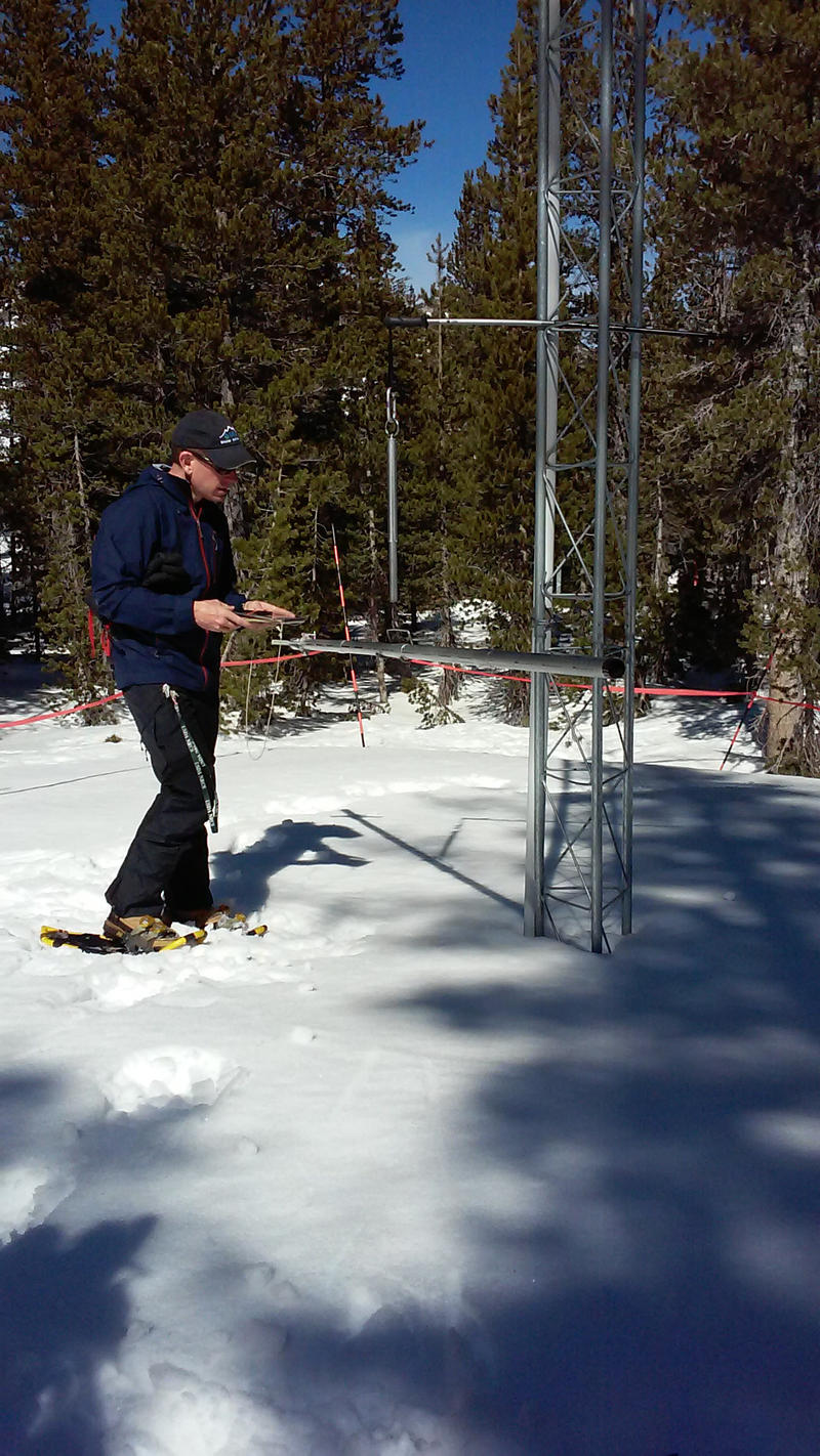 Hydrologist Jeff Anderson measures the snowpack at a snow telemetry site on Mt. Rose.