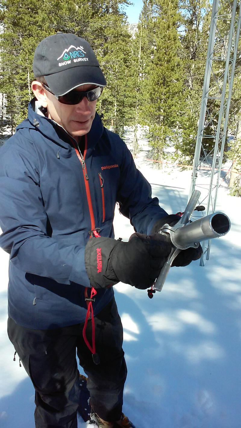 Anderson uses the Mt. Rose sampler device to collect data.