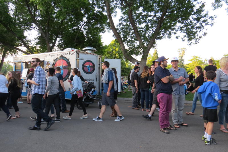 Diners meander up and down the street lined with food trucks at Idlewild Park in Reno.