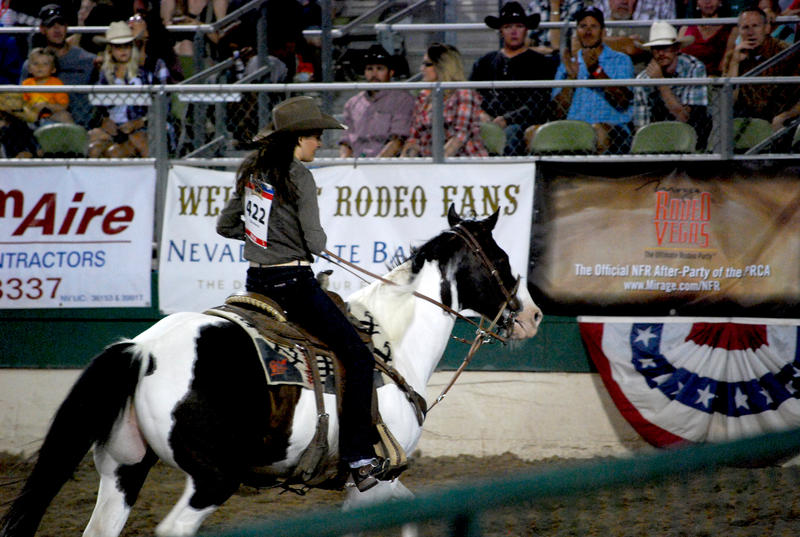 The winner of Tuesday night's Women's Barrel Racing event rides out of the arena.