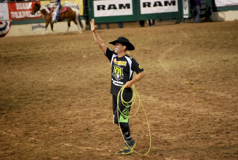 Rodeo clown JJ Harrison waves at the crowd at the arena at the Reno Rodeo Tuesday, June 21.