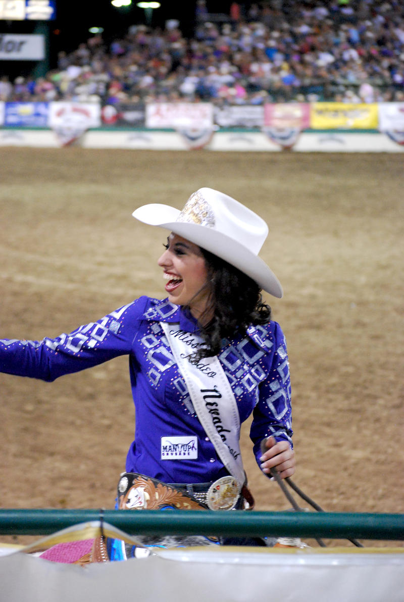 Miss Rodeo Nevada, Jasmyne Herrera, waves at an audience member.