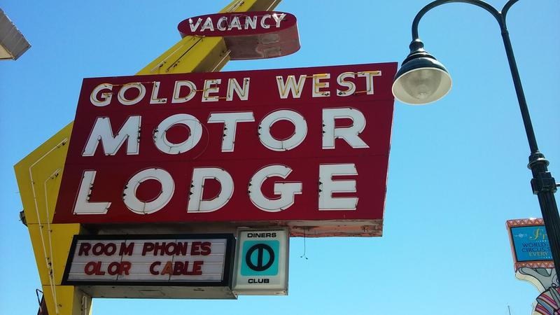 The neon sign for the Golden West Motor Lodge.
