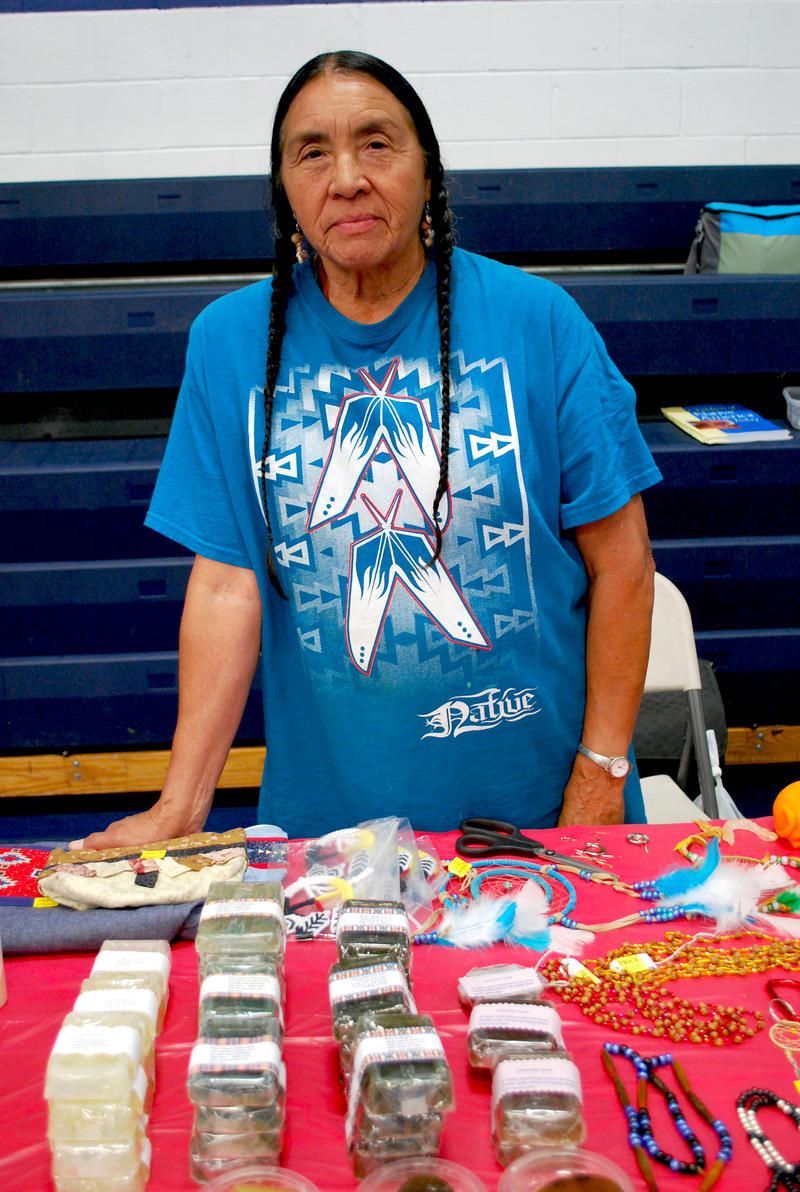 Darlene Graham of the Shoshone tribe with a selection of her medicinal products that she makes and sells. Darlene found a calling in teaching and giving demonstrations of her work