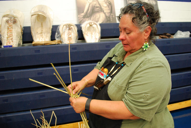 Gloria Johnnie Robles, of Shoshone and Mexican heritage, shows off her basketweaving technique. She is a member of the Great Basin Native Basketweavers Association