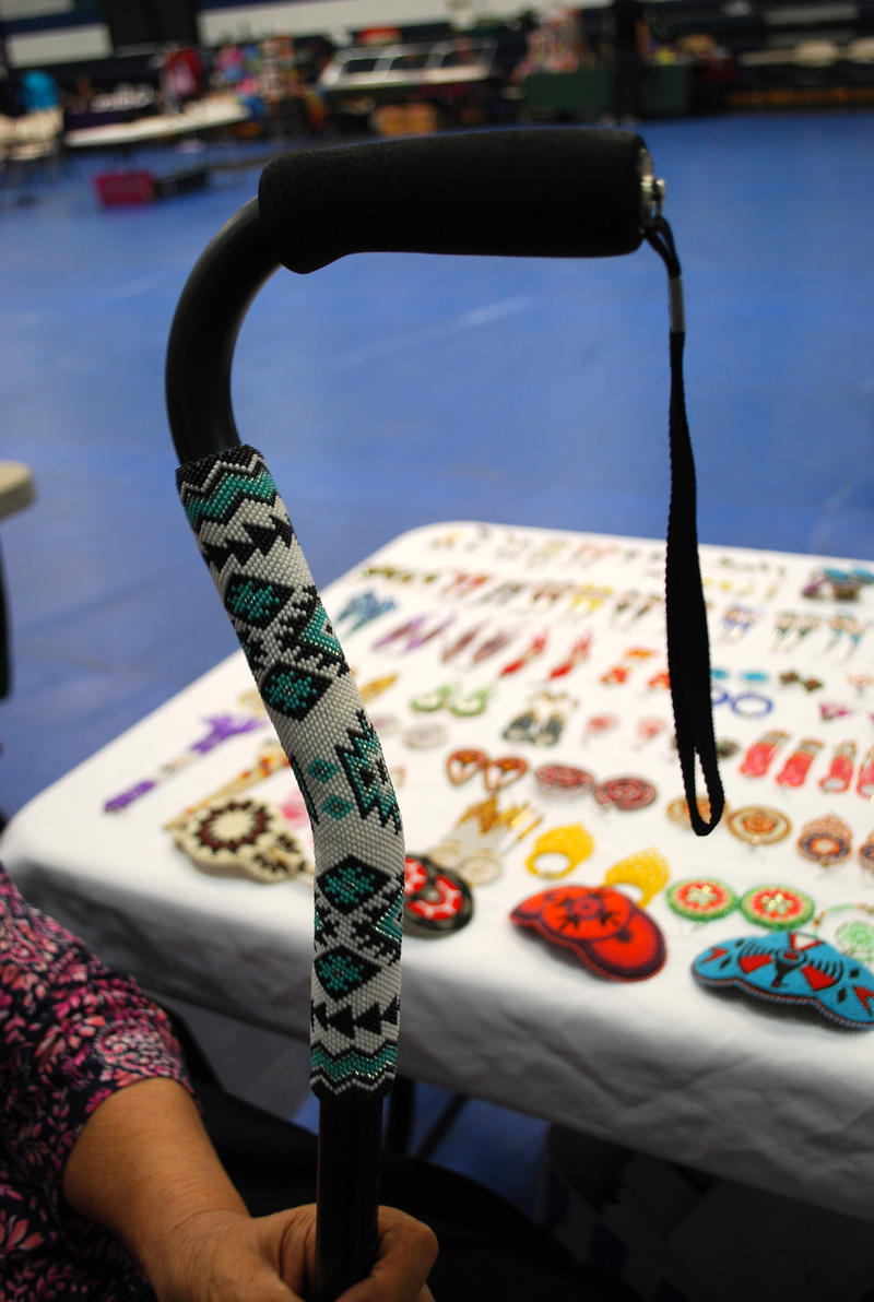 A cane decorated by members of Lovett Family Beadwork. The family has created beadwork objects for generations, and hopes to pass it on to their younger members as well