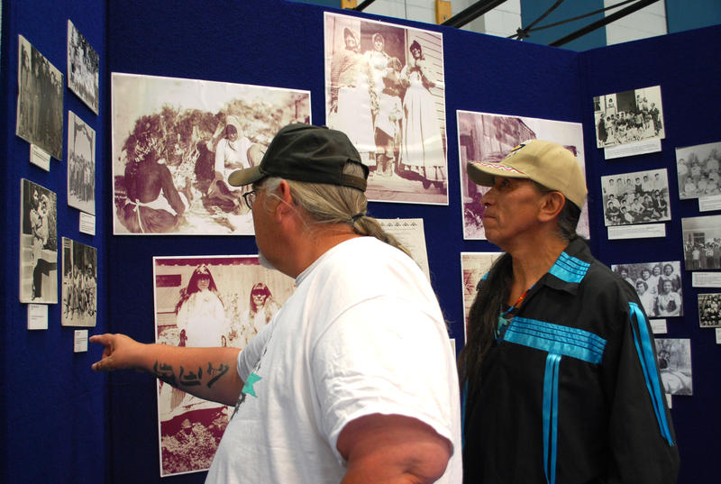 Danny Thayer, left, of the Shoshone and Paiute tribes, and Steve Nighthawk of Washoe, Paiute, and Shoshone background, take a look at some of the historical photos archived at the Reno-Sparks Indian Colony