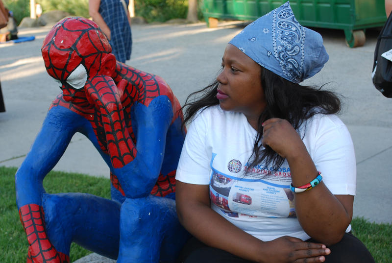 Tracey Sibanda, a Mandela Washington Fellow, hangs out with Spider Man in Wingfield Park for the opening night of Artown 2016. The Mandela Washington Fellowship for young African leaders is being held at the University of Nevada, Reno.
