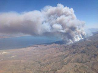 Fire crews conducted a burnout operation of the Tule Fire on Tuesday to contain the spread.