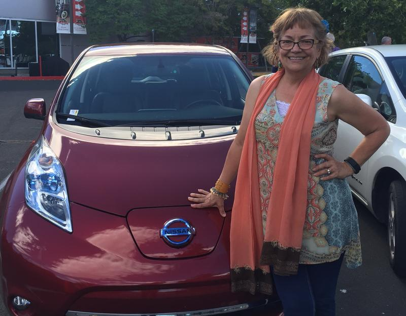 Cynthia Ryan is the only female member of the Electric Auto Association of Northern Nevada, or EANN. She attends an event at the Nevada Automobile Museum. She's pictured here with her Nissan Leaf.