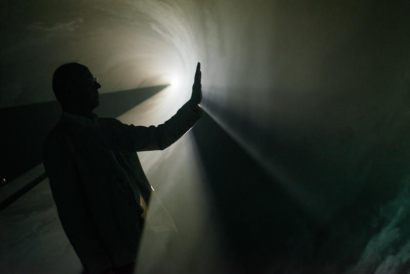 Artist Anthony McCall interacts with the light in his new exhibiton, Swell