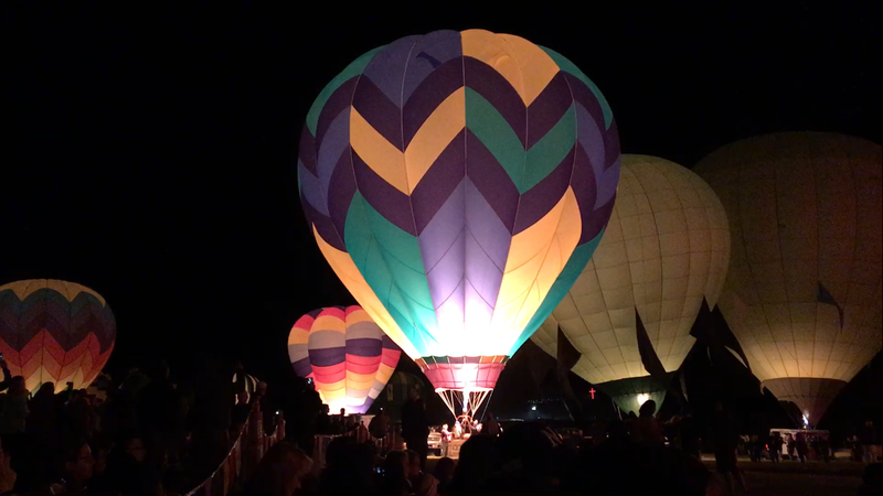 Hot Air Balloons light up in the fields of Rancho San Rafael during the Great Balloon Race's Super Glow Show.