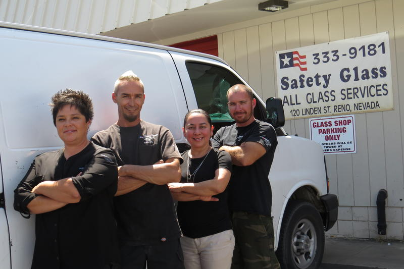Maury Centeno (second from right) owns Safety Glass, a shop for replacing broken windshields.