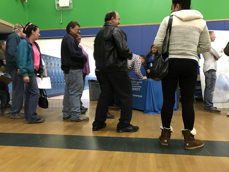 Lemmon Valley residents sign in and get information from Washoe County at Wednesday night's community meeting at O'Brien Middle School.