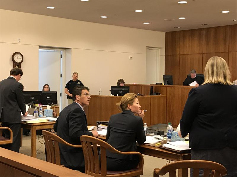 Lawyers for the state Department of Taxation deliberate during an all-day hearing in Carson City District Court Monday.