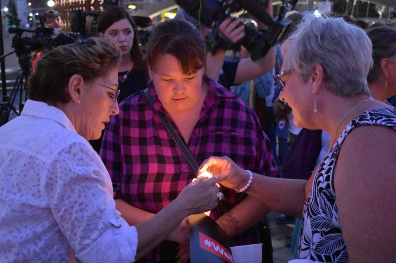 Participants in a vigil in downtown Reno light candles in honor of the victims of the violence caused by white nationalists in Virginia.