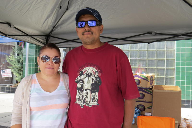 Mayra and Alberto Villa selling Buñuelos and ribbon fries at Fiesta on Wells.