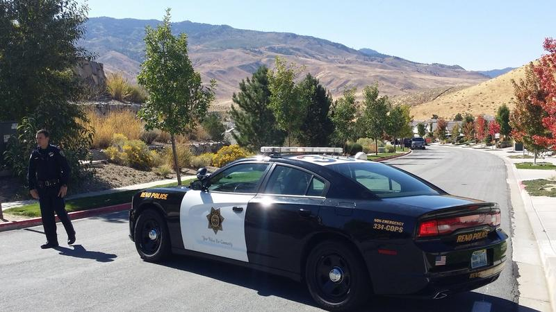 A Reno police officer blocks off a road that leads to a house owned by Stephen Paddock, the Las Vegas shooter who opened fire at a crowd attending a country music concert.