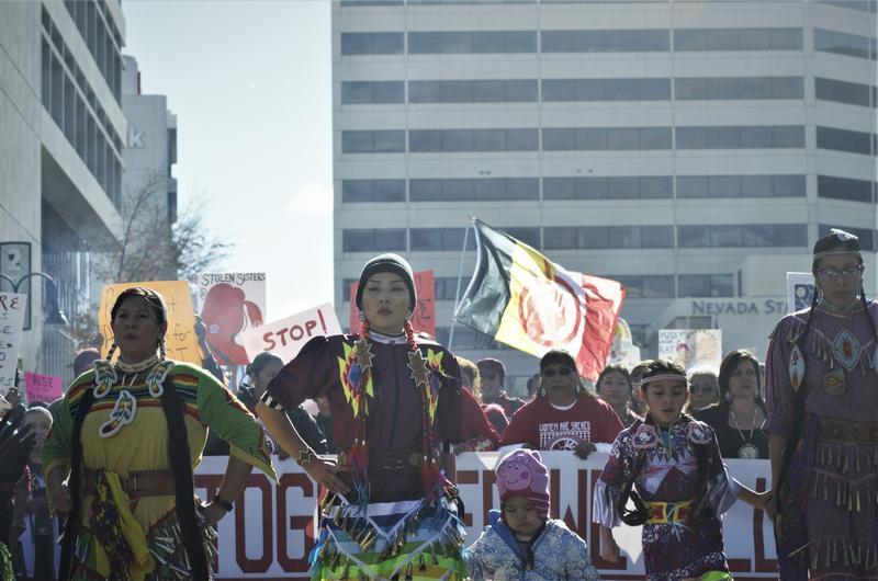 Indigenous women performing the jingle dress dance, leading over 10,000 people in protest for women's rights and other progressive causes.