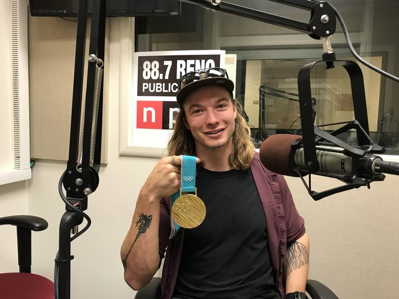 David Wise holds his gold medal from the Pyeongchang games while visiting the KUNR studios.