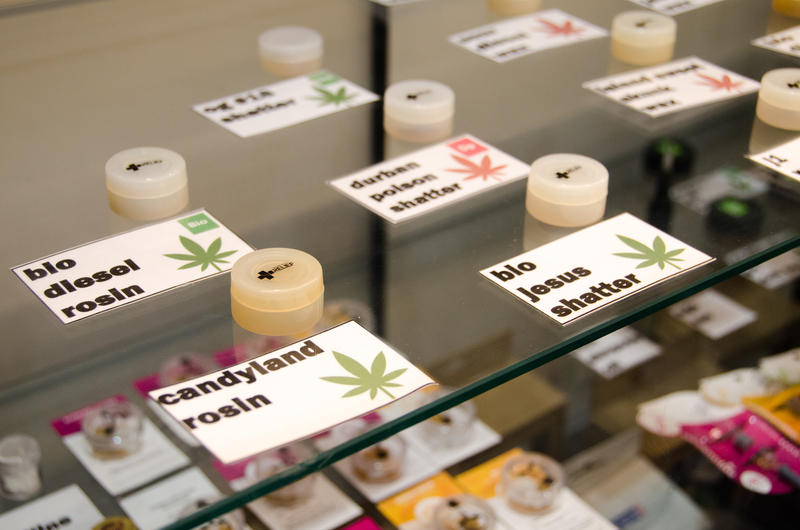An image of marijuana in a display case at a dispensary.