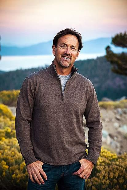 Andy Wirth poses with a scenic Tahoe backdrop