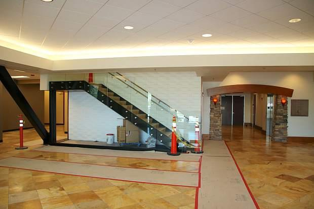 A lobby interior with a small staircase.