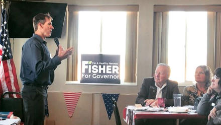 Jared Fisher speaks with voters