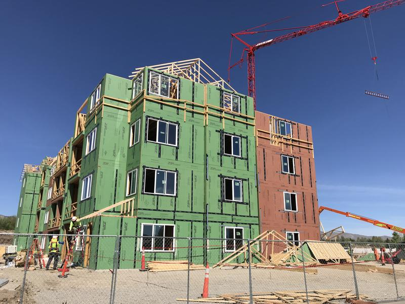 image of large residential building being constructed