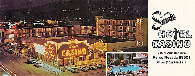 A dated postcard of the Sands Casino at night.