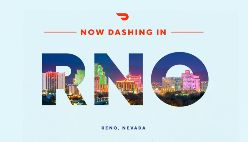 "A light blue advertisement reading ""Now Dashing In RNO"" to announce that Door Dash, a food delivery company, will begin operating in Reno."