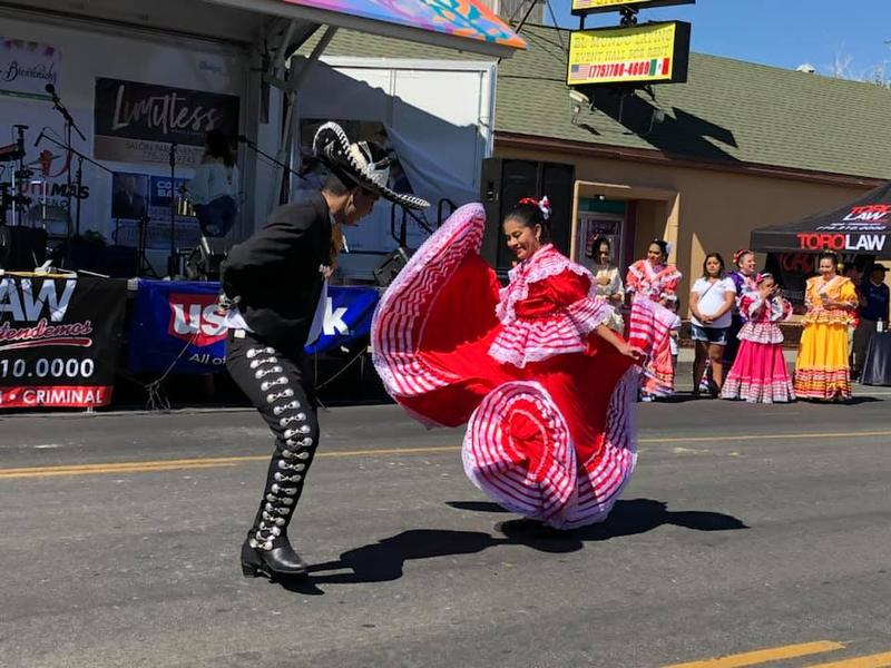 Dancers from local dance company Pueblo Nuevo prefrom on Fiesta on Wells.