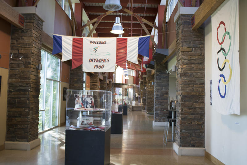 Banners that once hung in Olympic facilities and arenas as part of the 1960 games now hover overhead as visitors walk through the Truckee Community Rec Center.