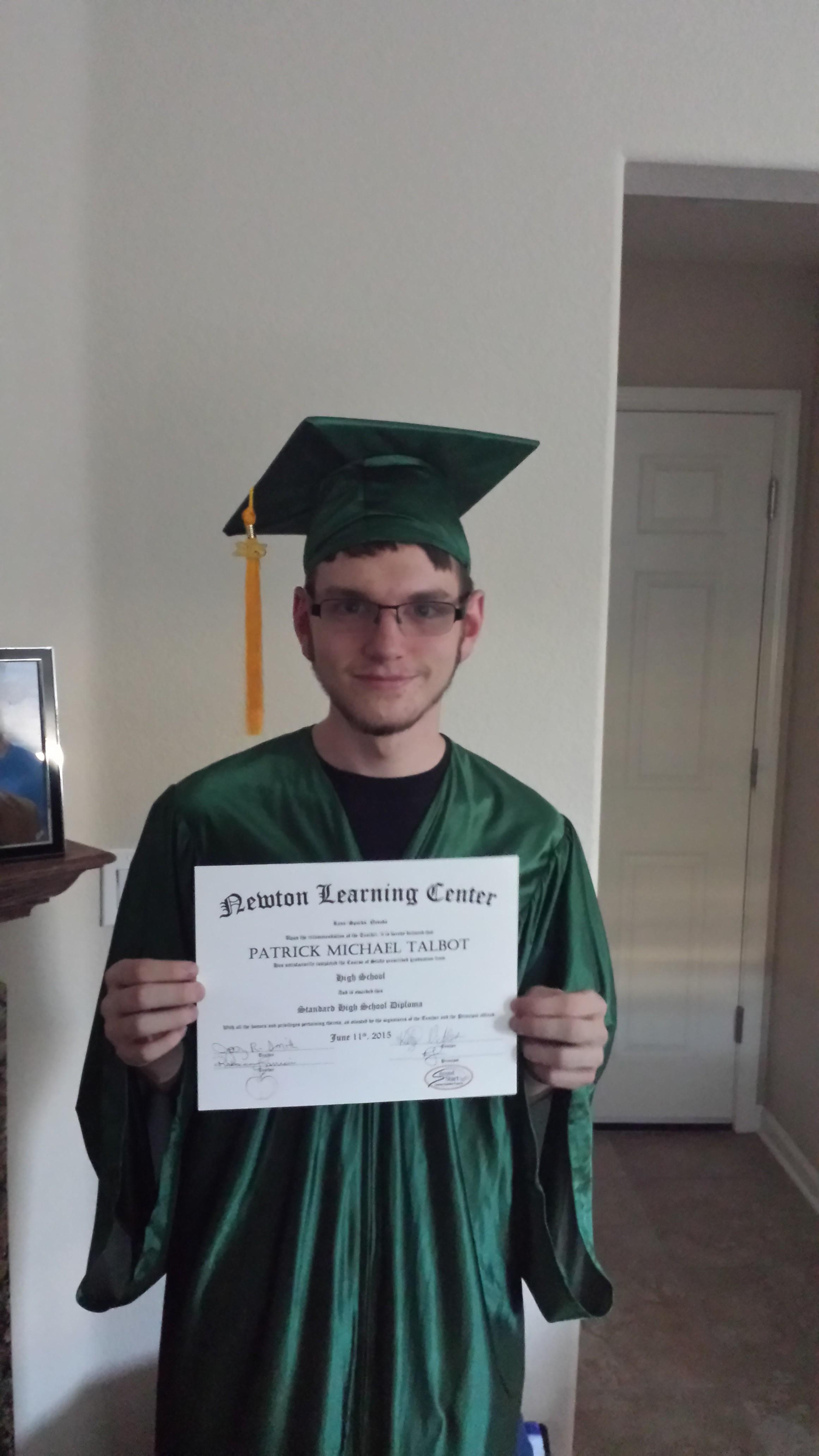 Patrick Talbot with his diploma from Newton Learning Center.