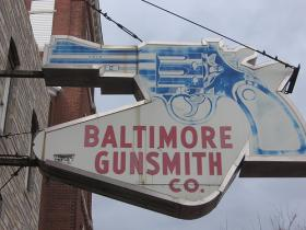Sign for the Baltimore Gunsmith Company.