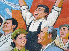 A man appears to be jumping for joy - or dancing - in this mural in Pyongyang, North Korea