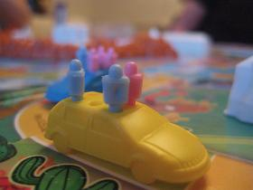 A game piece, shaped like a car, from the Game Of Life, a board game.