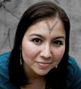 Alethea's face bears a traditional Inuit tattoo