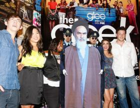 A cardboard cutout of the late Ayatollah Khomeini apparently schmoozing with the cast of Glee.
