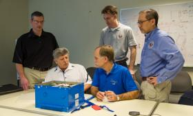 In Seattle, NTSB investigators and Boeing engineers examine the type of lithium ion battery used on the Boeing 787 to start the auxillary power unit and to provide backup power for flight critical systems.
