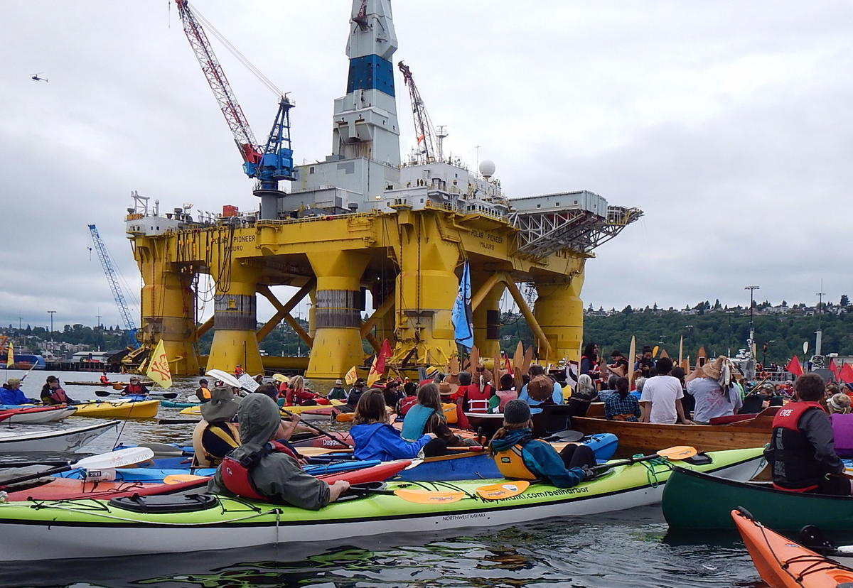 Seattle City Council member Kshama Sawant speaks from a Native canoe at an anti-Arctic drilling protest next to the Polar Pioneer oil rig on May 16.