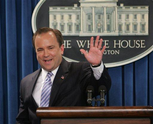 White House Press Secretary Scott McClellan waves as he leaves the podium, Friday, May 5, 2006, after finishing his last briefing at the White House.