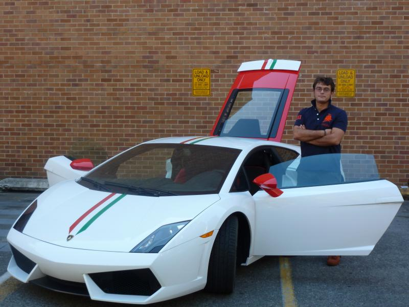 Paolo Feraboli stands next to a carbon fiber Lamborhini the colors of the Italian flag. It was built by his lab at the University of Washington.