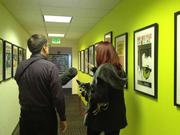 Lime green hallway covered with, you'll never believe this, BAND POSTERS!