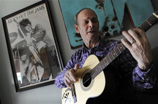 Guitarist Wayne Kramer, founder of the band the MC5, plays one of the instruments that will be provided to jail inmates as part of the Jail Guitar Doors USA initiative, Jan. 2012.